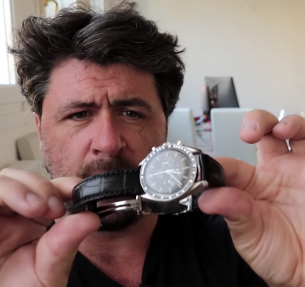 Oisin O'Malley holding his Speedy with the Black Alligator Watch Strap handmade by Michael Knapp Leather host of Strap a Watch